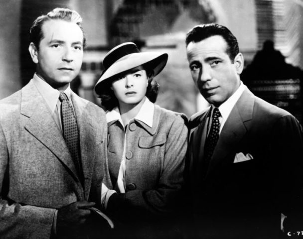 Medium shot of Paul Henreid as Victor Laszlo, Ingrid Bergman as Ilsa Lund, wearing hat, and Humphrey Bogart as Rick Blaine.
